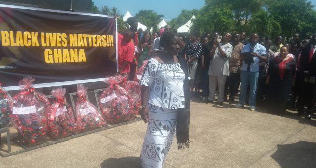 Elizabeth Ofosu-Adjare walking on after laying a wreath