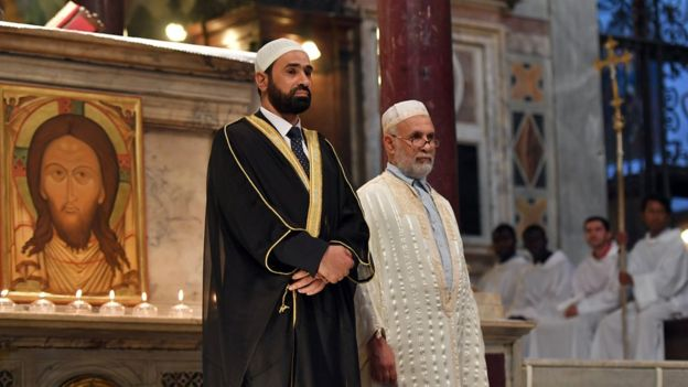 Imam Sami Saleem (L) and Imam Mohammed ben Mohammed stand before mass in Rome