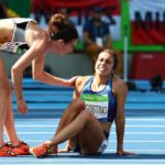 Olympic spirit: New Zealand and American runners help each other after collision
