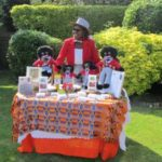 "English woman originally from Ghana sells ""golly dolls"" in UK to reclaim her identity"