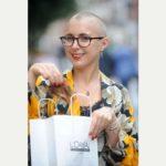International volunteer shaves hair to raise funds for Ghana Trip