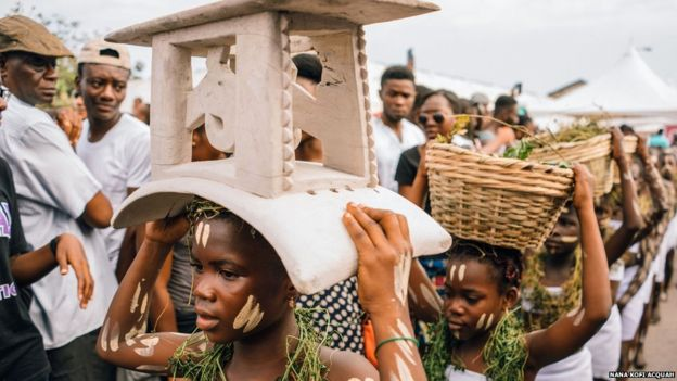 The festival, which is in its sixth year, extends to the city centre, where children perform a ritual as part of the Homowo harvest festival.