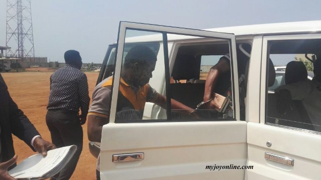 Tthe suspects as they enter the vehicle