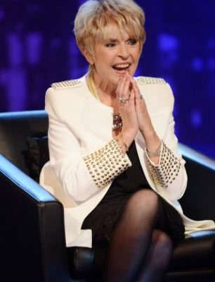 Rip Off Britain presenter Gloria Hunniford is scammed after 'lookalike' conwoman tricks bank cashier into draining her account of £120,000-but how on earth did she mistake her for the TV star?