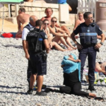 French police force Muslim woman to remove her Burkini on Nice beach (photos)