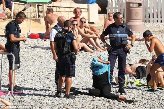 French police force Muslim woman to remove her Burkini on Nice beach (photos)