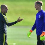 England Goalkeeper JOE HART Locked in a Tense Exchange with Manchester City Boss Pep Guardiola.