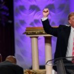 US election: Donald Trump woos black vote at Detroit church
