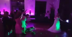 Video: The hustle is real! Watch this guest's valiant attempt to catch bride's bouquet