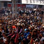 Police fire tear gas on Chinese 'democracy village' protesters