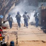 Mugabe opponents vow mass protests despite warning