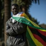 Zimbabwe warns flag 'abusing' protesters