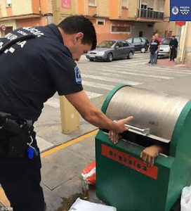 Man gets rescued after climbing inside a waste bin and getting stuck (Photos)