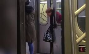 Old lady's head gets stuck in subway car and passersby walk by without helping (video)