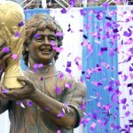 Diego Maradona unveils 12ft statue of himself holding World Cup in India... but its dodgy likeness risks ridicule