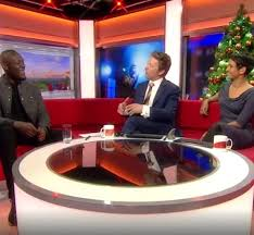 Viewers shocked as BBC accidentally shows footage of a man waving a large sex toy during interview
