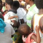 Frustrated single mothers feeding hungry babies with Akpeteshie