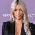 PHOTOS: Kim Kardashian poses topless in a sultry bedroom photo