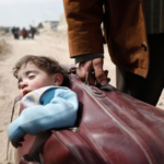 Heartbreaking photo: Father flees war-torn Syria with his son in a suitcase
