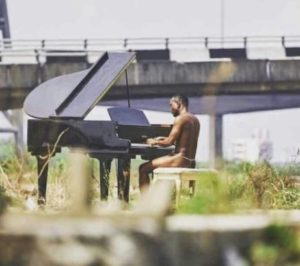 PHOTOS: Nigerian singer, Brymo shocks Africa as he appears in only 'G-String' for video shoot