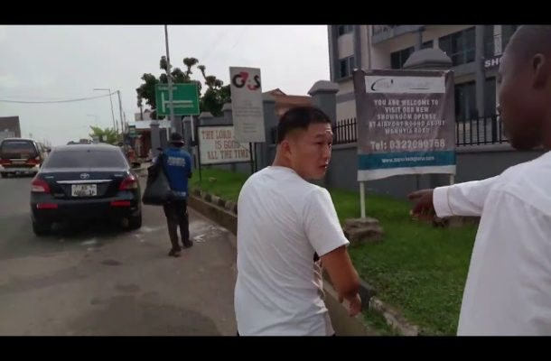 VIDEO: Chinese man living in Ghana ordered to pick trash from gutter after he was caught littering