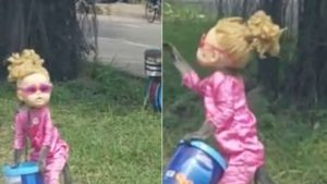 VIDEO: Anger as monkey is forced to wear doll's head, dress up as a girl to beg at road side