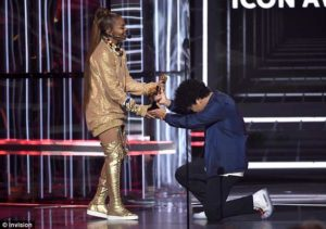 PHOTOS: Bruno Mars kneels down to present Icon Award to Janet Jackson at BBMAs 2018