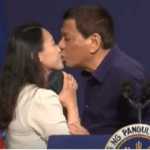 Philippine president criticized for kissing woman on stage