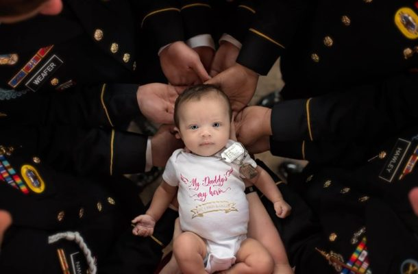TOUCHING: Colleagues of soldier who died at battle unite for photoshoot with his baby