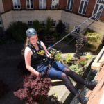 Fundraising strategy: British students abseil giant Ecotricity building for Ghana trip