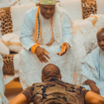 PHOTOS: Davido goes flat on the ground as he pays courtesy visit to Yoruba chief