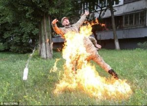 SHOCKING PHOTOS: Soldier sets himself on fire to protest after he was sacked