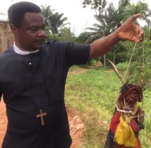 SHOCKING PHOTOS: Pastor shows off evil deity he physically 'defeated' inside a devilish shrine