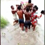 Angry Ghanaians react to video of woman in labor carried across a river to a Hospital