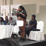 PHOTOS: Rape victim strips naked in public to show South Africa president scar inflicted by rapists