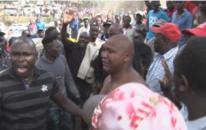 PHOTOS: Police rescue 35-year-old man in tears as his friends attempt to forcefully circumcise him