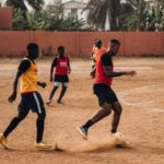 VIDEO  Jerome Boateng plays football with kids on bare pitch in Accra