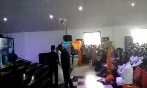 VIDEO: Drone flies rings to Ghanaian couple in church on wedding day