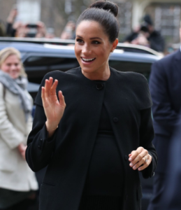PHOTOS: Meghan Markle steps out looking regal in a sleek topknot and an all-black outfit