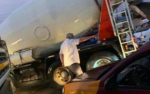 PHOTOS: Ex President Rawlings controls traffic on Accra-Prampram road