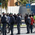 First batch of migrants transferred as Italy begins to close asylum centre