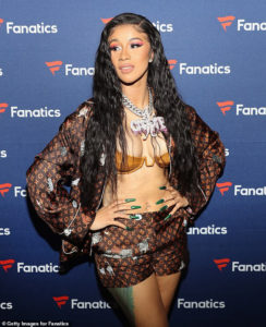 PHOTOS: Cardi B flaunts her boobs in skimpy gold bra and shorts at Fanatics Super Bowl party