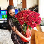 Emmanuel Adebayor surprises his girlfriend Dillish Mathews with giant bouquet of red roses on Valentine's Day