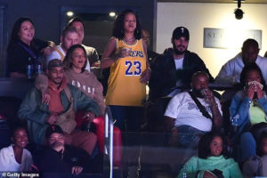 PHOTOS: Rihanna and her billionaire boyfriend pictured together at star-studded Los Angeles Lakers game