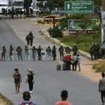 Venezuela closes Colombia border as aid dispute turns deadly