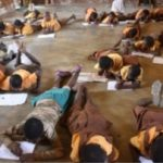 E/R: Students 'forced' to lie on the floor to write exams