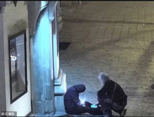 PHOTOS: Taxi driver caught on CCTV stealing the phone of a 'drunk' man who passed out on the street