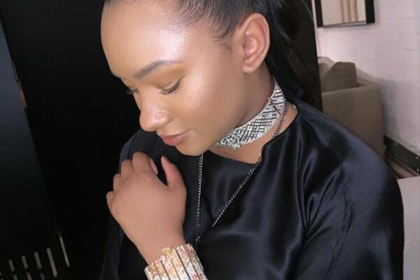 PHOTOS: Mr. Eazi's billionaire heiress girlfriend Temi Otedola wears £1.4m Chanel wristband