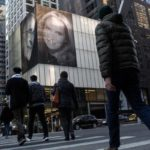 PHOTOS: US Billionaire puts up giant photos of him and new wife on buildings to spite ex wife