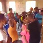 DRAMA: Pastor locks lips with young woman for very long time to 'rid her body of demons'